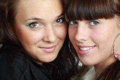 Two beautiful brunettes. Portrait of two beautiful brunettes smiling royalty free stock photography
