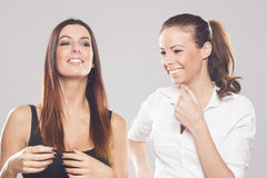 Two beautiful business women on studio background Royalty Free Stock Images
