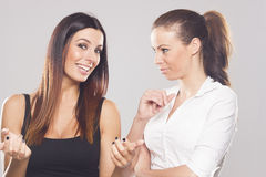 Two beautiful business women on studio background Stock Photos