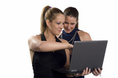 Two beautiful business women working on the laptop Royalty Free Stock Image