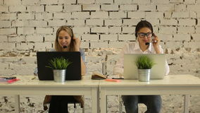 Two beautiful businesswoman working. In call center stock footage