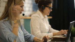 Two beautiful businesswoman working. In call center stock video