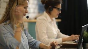 Two beautiful businesswoman working stock video
