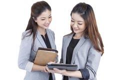 Two beautiful businesswomen working Stock Photography