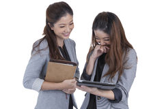 Two beautiful businesswomen working Stock Images