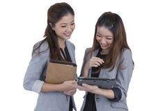 Two beautiful businesswomen working Stock Photos