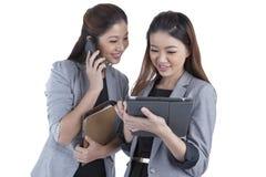 Two beautiful businesswomen working Stock Photo