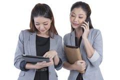 Two beautiful businesswomen working Royalty Free Stock Photo