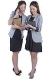 Two beautiful businesswomen working Royalty Free Stock Image