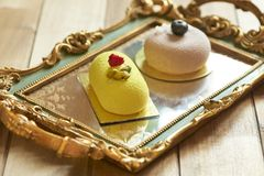 Two beautiful cakes on vintage tray. Two tasty and beautiful cakes on vintage tray Royalty Free Stock Photo