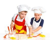 Two beautiful caucasian brothers making a cake Royalty Free Stock Photos