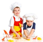 Two beautiful caucasian brothers making a cake Royalty Free Stock Image