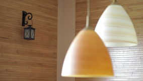 Two beautiful chandeliers on the background of wooden wall.  stock video footage