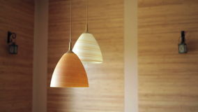 Two beautiful chandeliers on the background of wooden wall.  stock footage