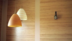 Two beautiful chandeliers on the background of wooden wall.  stock video