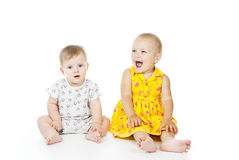 Two beautiful child sit and play Stock Photography