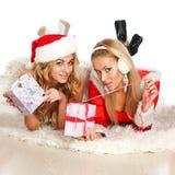 Two beautiful Christmas girl open gift Stock Photos