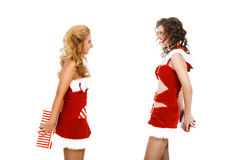 Two beautiful christmas girls isolated white background holding gifts. Royalty Free Stock Photo