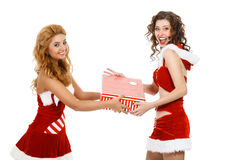 Two beautiful christmas girls isolated white background holding gifts. Stock Image
