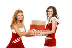 Two beautiful christmas girls isolated white background holding gifts. Royalty Free Stock Photos