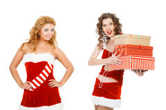 Two beautiful christmas girls isolated white background holding gifts. Royalty Free Stock Images