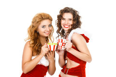Two beautiful christmas girls isolated white background with tea pairs Stock Photo