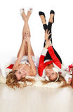 Two beautiful christmas girls are upside down Stock Photography