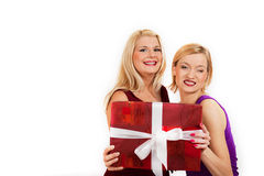 Two beautiful christmas woman holding red present Royalty Free Stock Photography