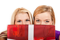 Two beautiful christmas woman holding red present Royalty Free Stock Photo