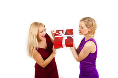 Two beautiful christmas woman holding red present Stock Photos