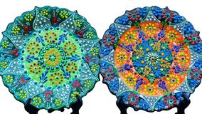 Two beautiful colorful plates with traditional Turkish flower ornate, isolated on white background stock photos