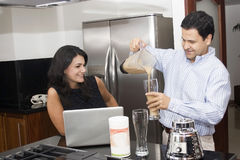 Two beautiful couple cooking in kitchen Royalty Free Stock Images
