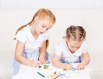 Two beautiful, cute little girls are drawing. Family, home conce Stock Photo