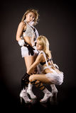 Two beautiful dancer girl in white costumes Royalty Free Stock Photo