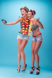 Two beautiful emotional girls in pinup style Stock Image