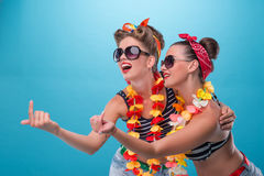 Two beautiful emotional girls in pinup style Royalty Free Stock Image
