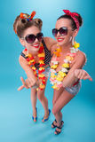 Two beautiful emotional girls in pinup style Royalty Free Stock Photos