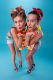 Two beautiful emotional girls in pinup style Royalty Free Stock Photo