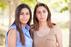 Two Beautiful Ethnic Twin Sisters Portrait Outdoors. Two Beautiful Ethnic Twin Sisters Pose for a Portrait Outdoors stock images