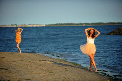 Two beautiful fashion models enjoy the beach Royalty Free Stock Image