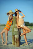 Two beautiful fashion models enjoy the beach Stock Photos