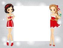 Two Beautiful Fashion Santa Girls Holding Banner Stock Photo