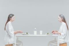 Two beautiful fashion women having lunch Stock Images