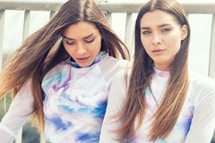 Twins female models posing outdoor. Stock Images
