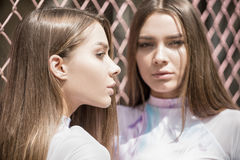Twins female models posing outdoor. Stock Photography