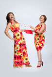 Two beautiful fashionable women in dresses Royalty Free Stock Images