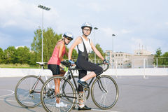 Two beautiful female cyclists taking a break outdoors. Stock Image