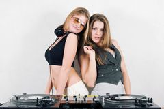 Two beautiful female djs. Couple of attractive young girls playing music from vinyl Stock Image