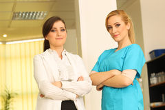 Two beautiful female doctors smile at work. Medical nurse Stock Photography