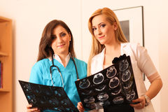 Two beautiful female doctors smile at work Stock Photo